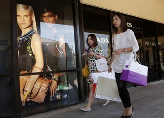 Outlet malls work to keep shoppers coming back