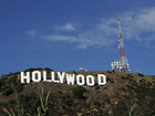Man climbs iconic Hollywood sign, holds banner