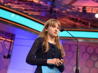 Teen enjoying Spelling Bee spotlight