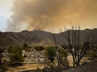 Firefighters advance on deadly Calif. wildfire