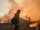 Thousands chased from homes by Calif. wildfires