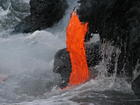 1000s rush to see Kilauea lava flow reach ocean