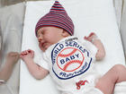 Indians get boost from newborn babies in onesies