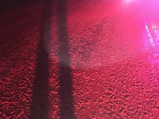 Thousands of Skittles end up on an icy road