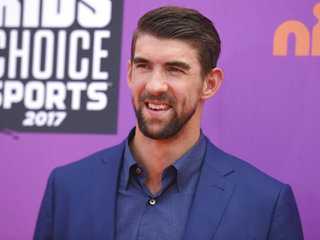 Viewers call Phelps' race against shark a scam