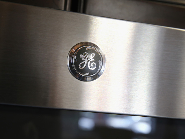 GE slightly up after moving to cut divi by 50%