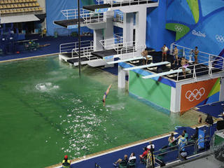 Olympic pool with green water to be drained