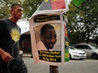 Officers served with charges in Eric Garner case